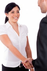 woman shaking hands with attorney